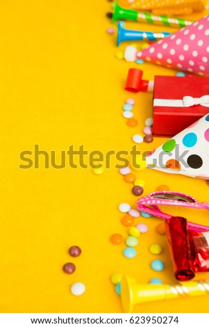 children party background. birthday background. Colorful party frame with  cap and whistle  on yellow background