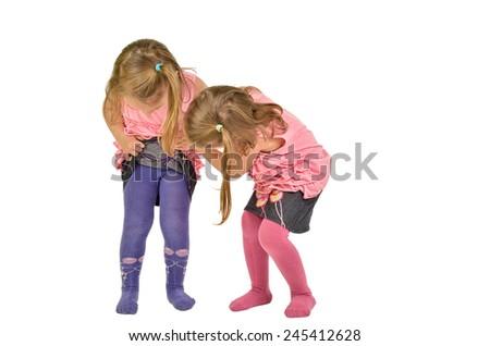 Children peeking under the Skirt. Children Curiosity on white - stock photo