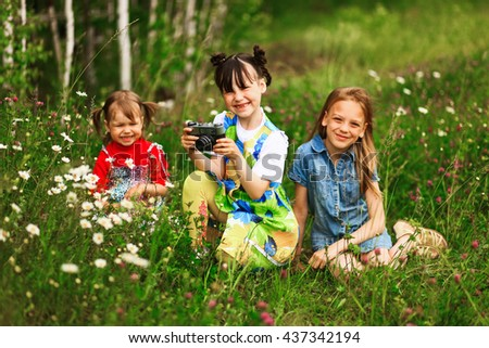 Children pictures of flowers on the meadow. - stock photo