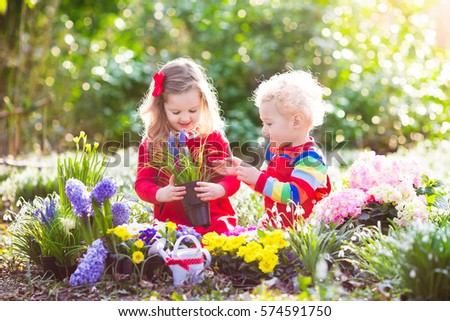 Children planting spring flowers sunny garden stock photo royalty children planting spring flowers in sunny garden little boy and girl gardener plant hyacinth mightylinksfo Choice Image