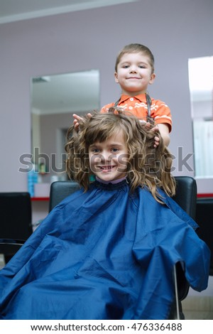 children play in the barbershop