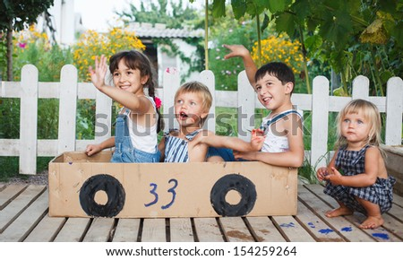children play in the car - stock photo