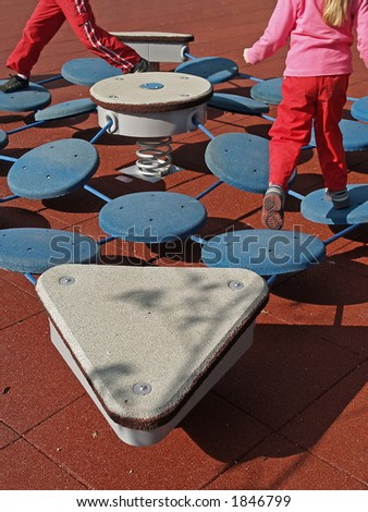 Children play on new jump spring equipment, close-up - stock photo