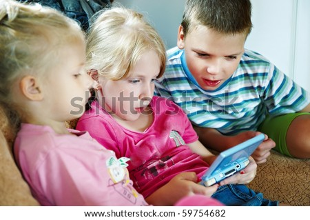 Children play on the computer game console