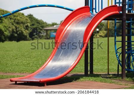 children playground at pubic park in summer season  - stock photo
