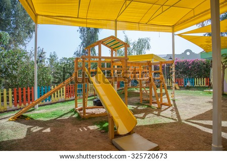 Children playground in the shadow under the tent in Egypt. Protection from the sun. & Children Playground Shadow Under Tent Egypt Stock Photo 325720673 ...