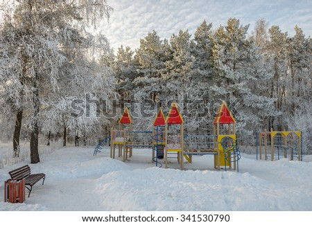 Children playground in winter park