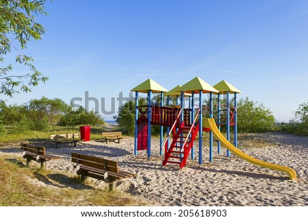 Children playground on sand at the sea.