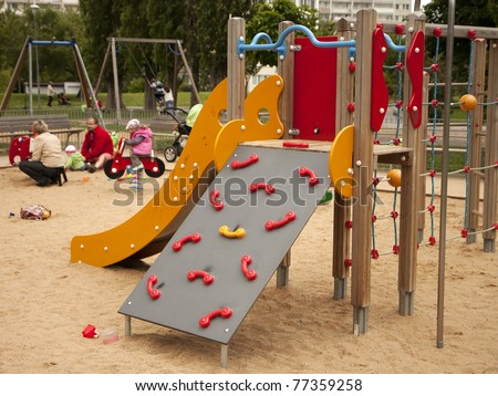 Children playground - slide and climbing frame - stock photo