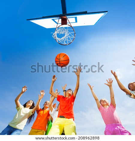 Children playing basketball view from bottom - stock photo
