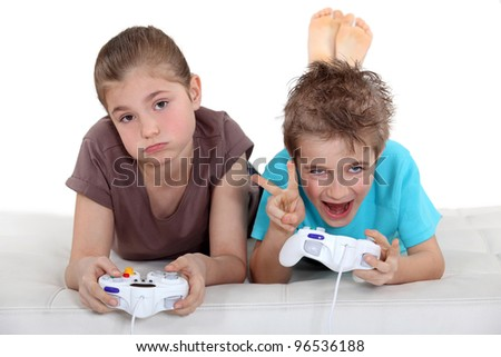 Children playing computer games - stock photo