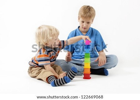 Children playing educational toys isolated on white - stock photo