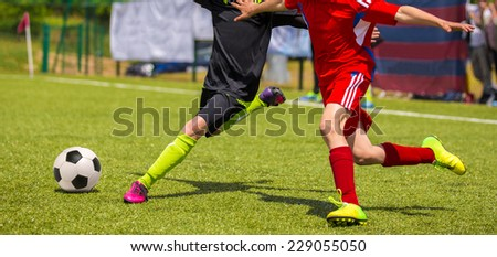 Children playing football soccer. Football soccer match for children. Training and football soccer tournament - stock photo