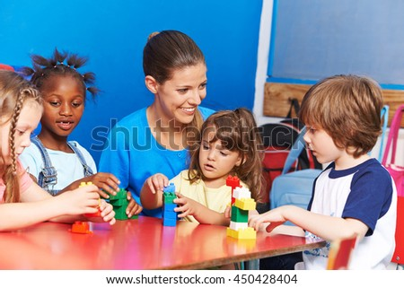 Children playing in child care in after-school care club - stock photo