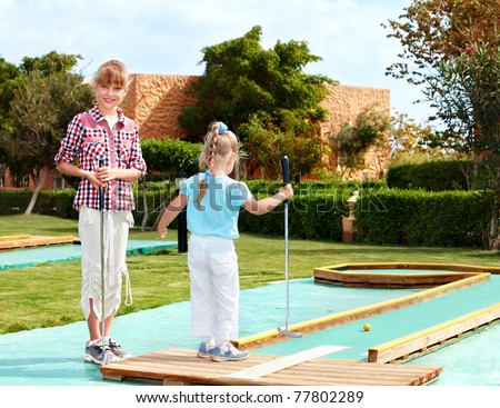 Children playing in golf. - stock photo
