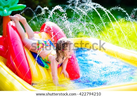 Swimming pool family stock images royalty free images for Kids swimming pool garden