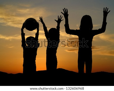 children playing in nature evening time with sunset