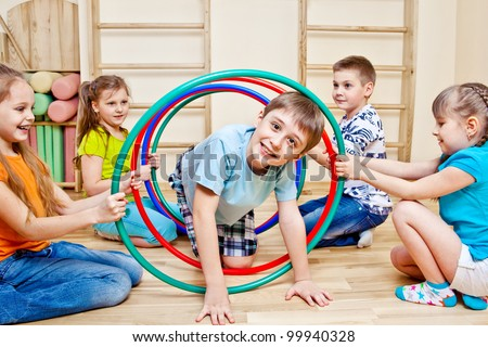 Children playing in school gym - stock photo