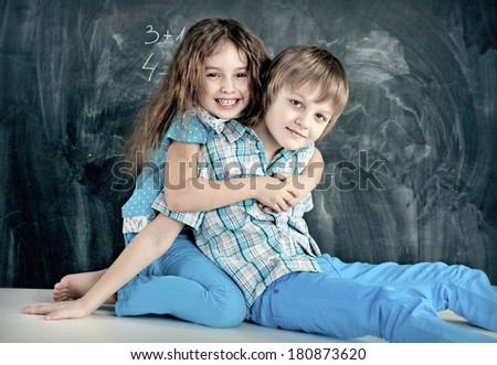 children playing in the school pupils - stock photo