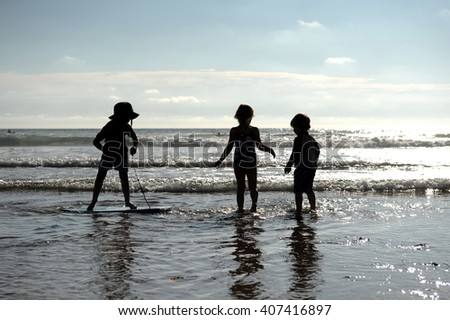 Children playing in the sea, Cornwall, uk