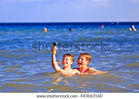 Children playing in the sea. Shooting on a waterproof camera