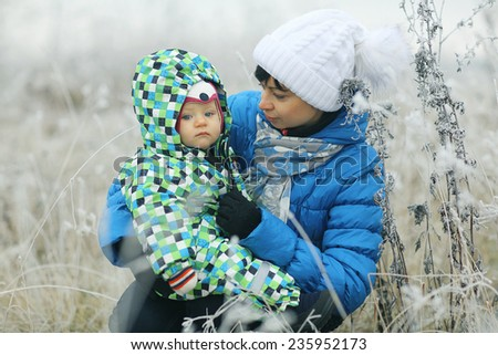 children playing in the winter field