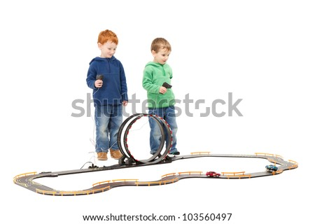 Children playing kids racing toy electric slot car game. On white.