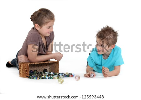 children playing marbles - stock photo