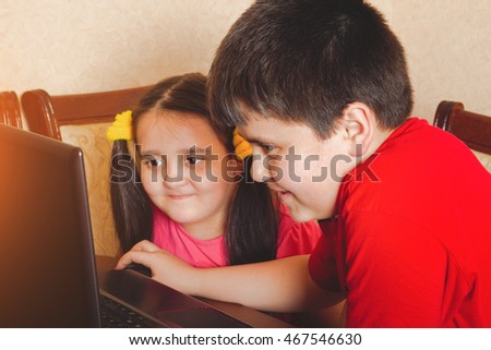 Children playing on a laptop,photo with tonal correction