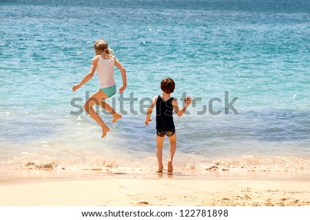 Children playing on a sand beach
