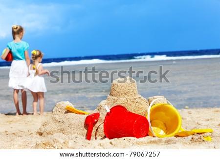 Children  playing on  beach. - stock photo