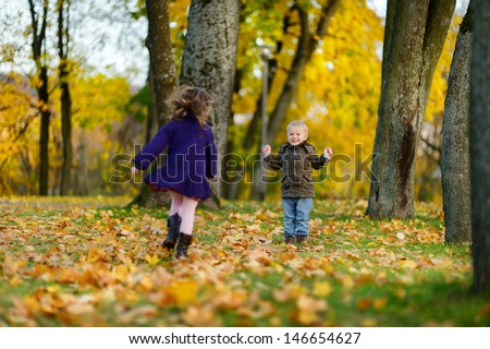 Children playing on beautiful autumn day