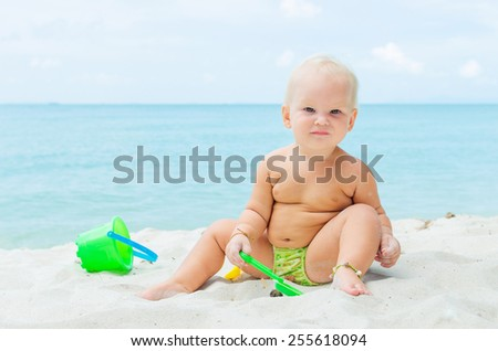 Children playing on the coastline - stock photo
