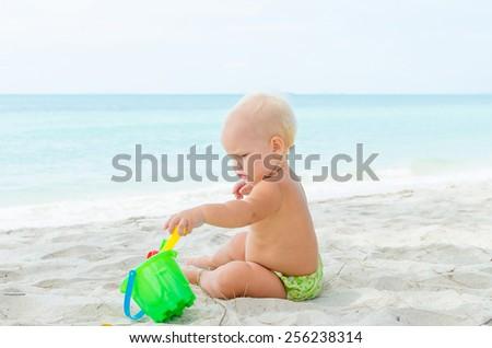 Children playing on the coastline - stock photo