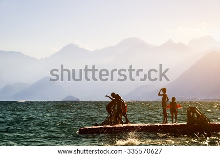 children playing on the platform in the sea