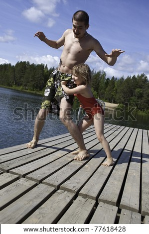 Children playing on the river in summer - stock photo