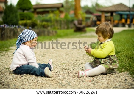 children playing on the stones road - stock photo