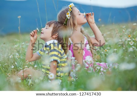 Children playing outdoors - stock photo