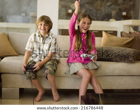 Children playing playstation. - stock photo