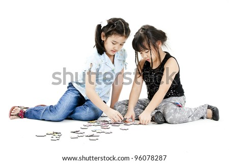 Children playing puzzle