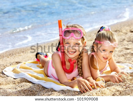 Children  playing summer outdoor on  beach. - stock photo