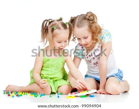children playing with color toy over white background - stock photo