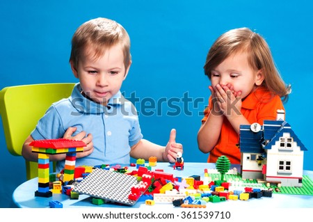 Children playing with construction blocks - stock photo