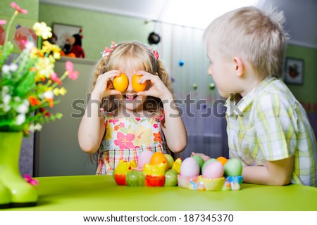 children playing with Easter eggs