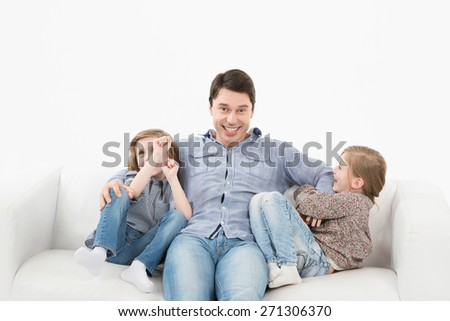Children playing with father - stock photo