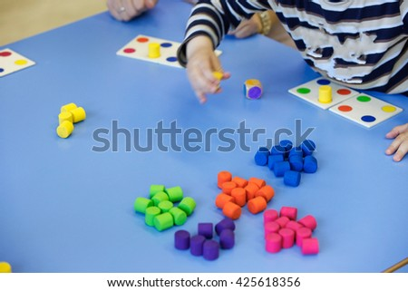 Children playing homemade doityourself educational toys stock photo children playing with homemade do it yourself educational toys arranging and sorting solutioingenieria Image collections