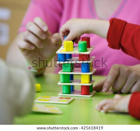 Children playing homemade doityourself educational toys stock photo children playing with homemade do it yourself educational toys stacking and arranging solutioingenieria Image collections