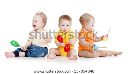 Children playing with musical toys - stock photo