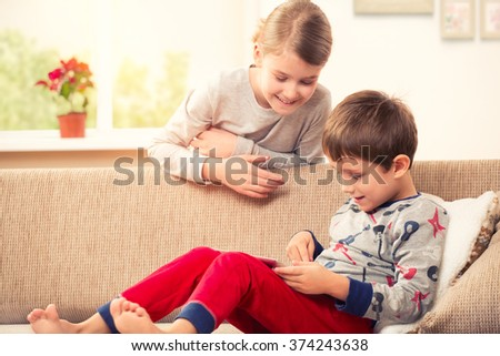 Children playing with tablet pc - stock photo