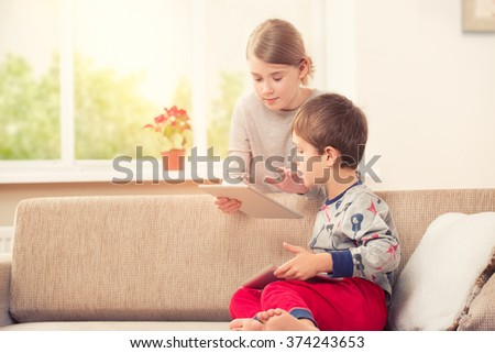 Children playing with tablet pc